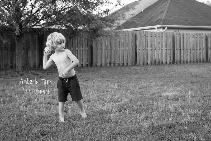boy throwing a baseball