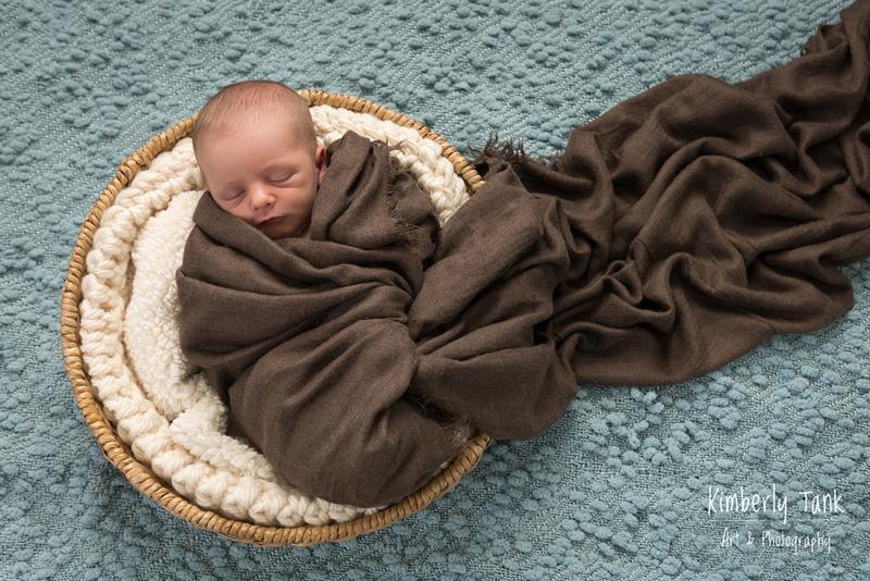newborn in a wrap & basket