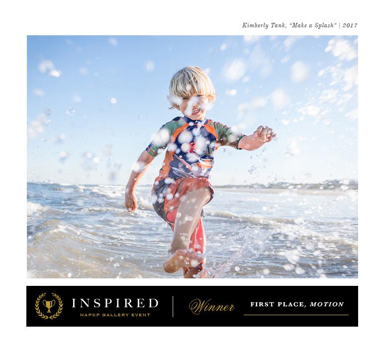 boy splashing water in waves at beach