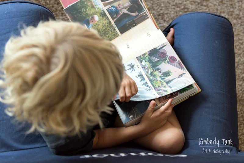 boy looking at photo album