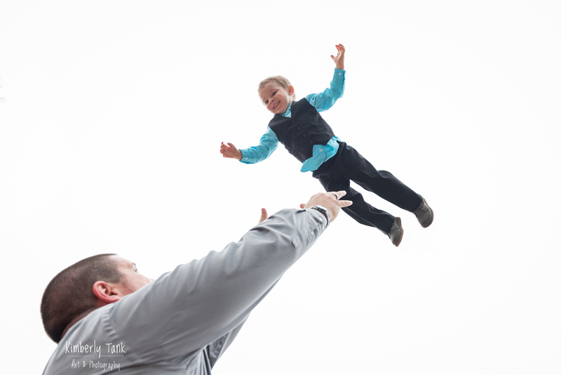 Dad tossing son into air