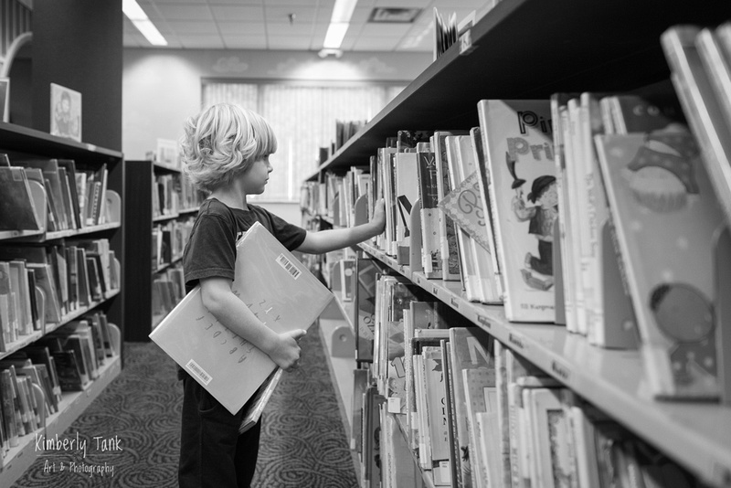 boy at the library choosing books