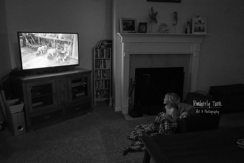 boy watching a movie at home